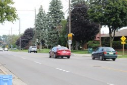 cars on road with traffic light in backgorund