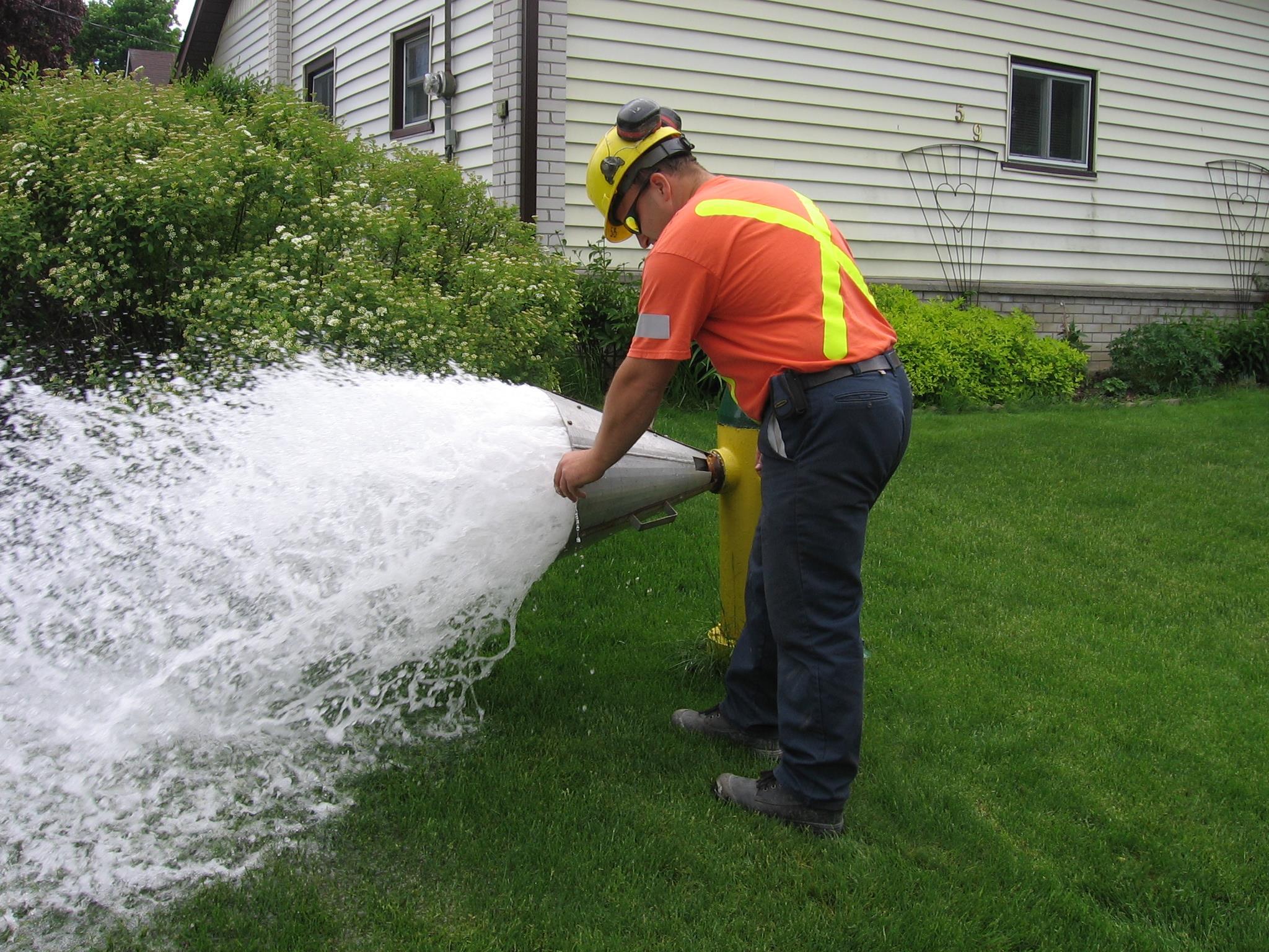 City worker flushing a watermain