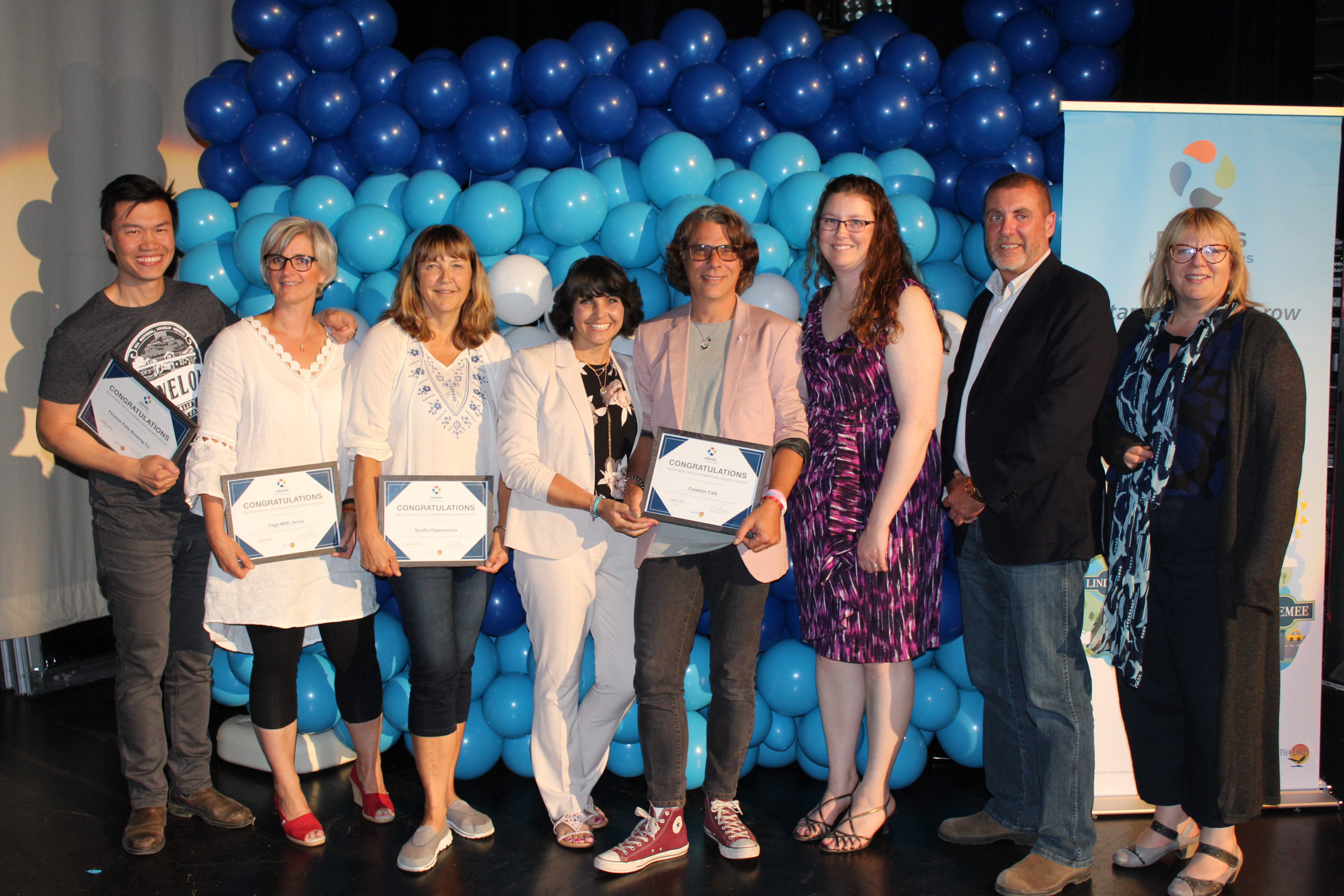 All Downtown Dreams contest finalists with their awards and Mayor Letham