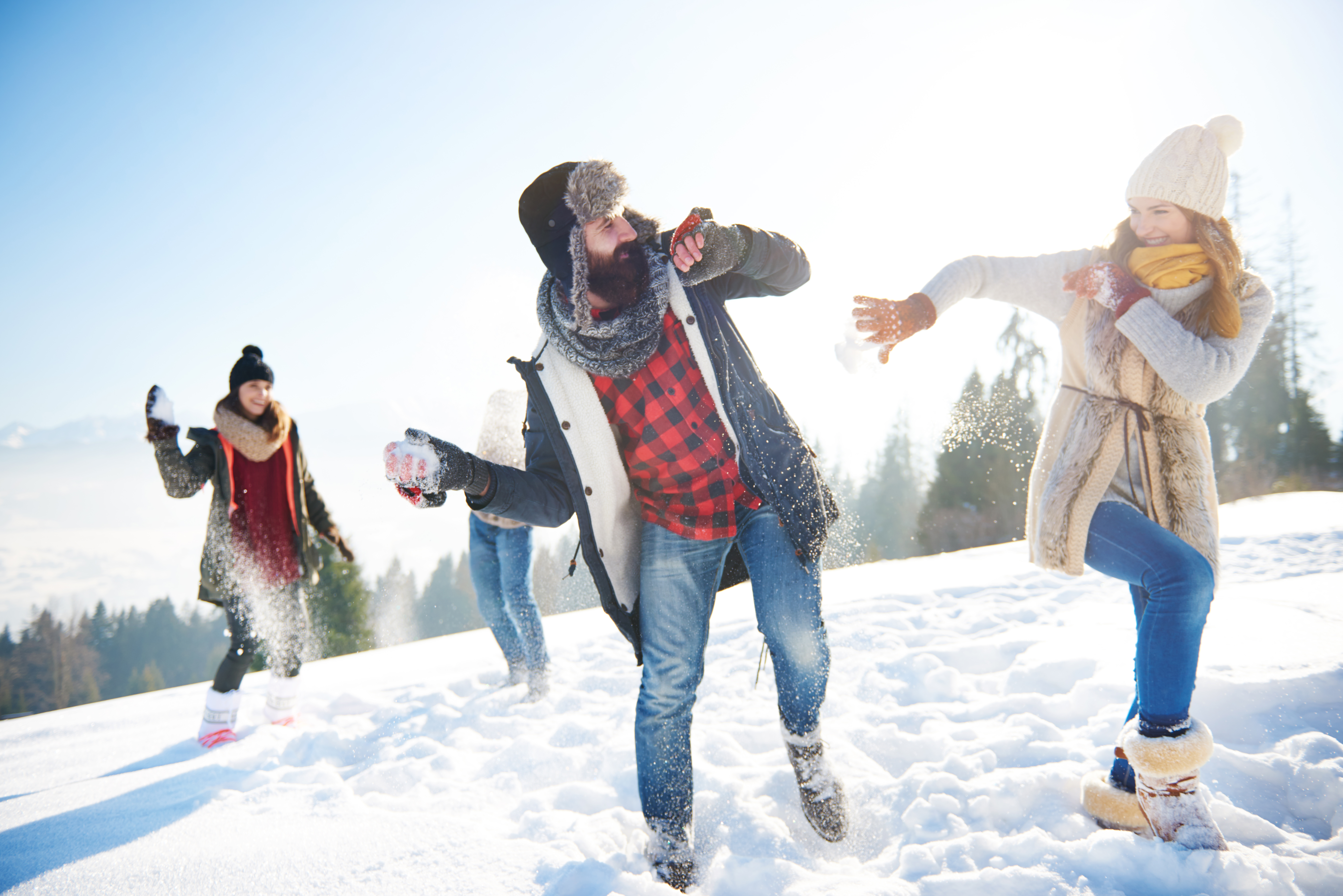 cheerful-couple-playing-in-the-snow-QKQ25P8