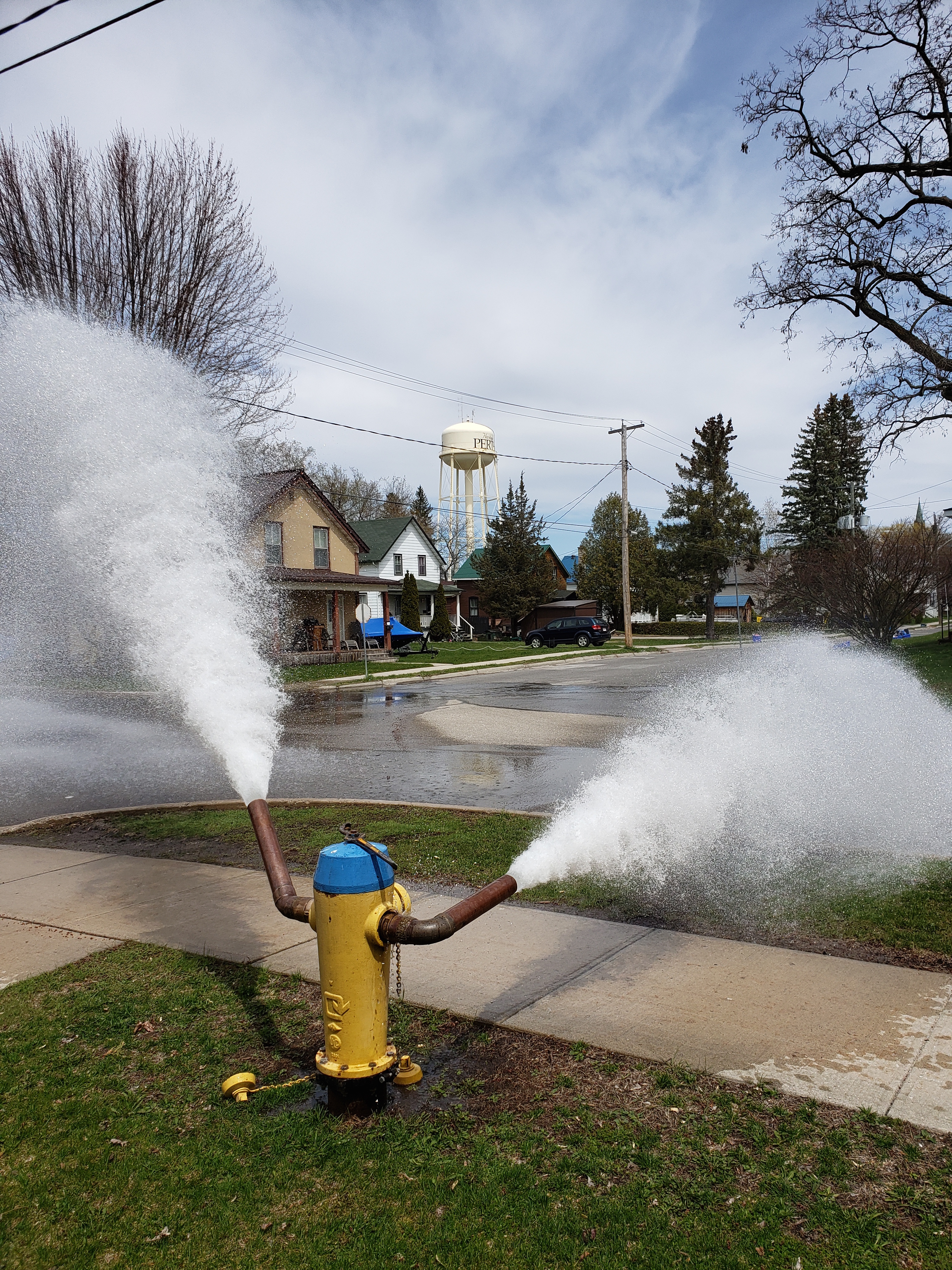 Hydrant flushing in front of Town Hall