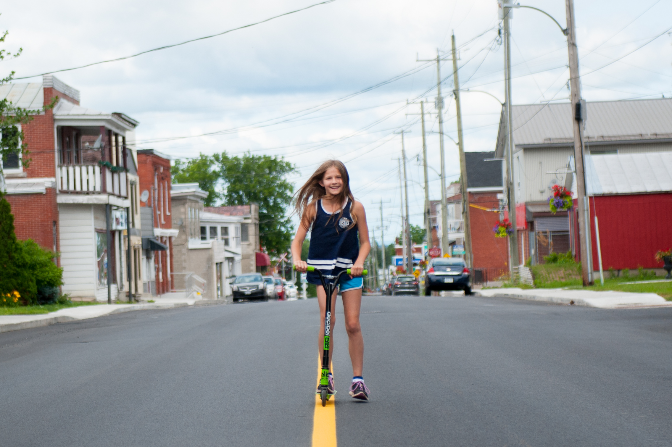 A youth poses on Maxville's freshly paved streets