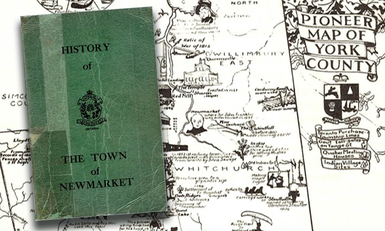map of newmarket with rare history book on top