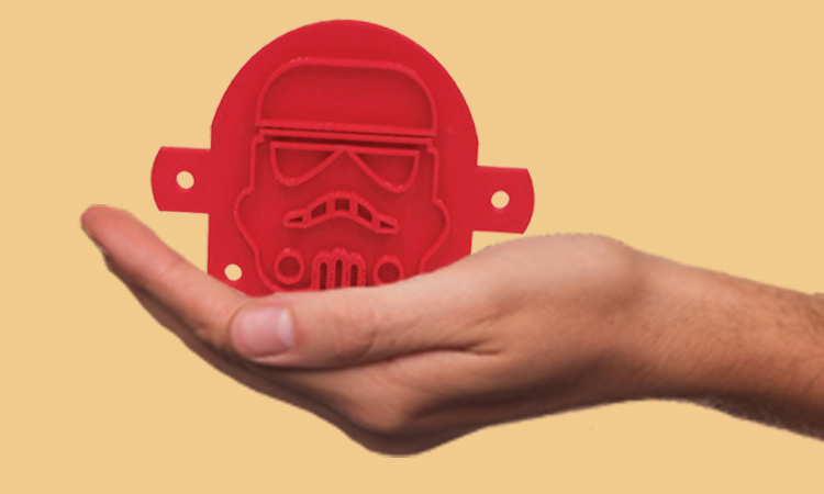 hand holding star wars stormtrooper toast press