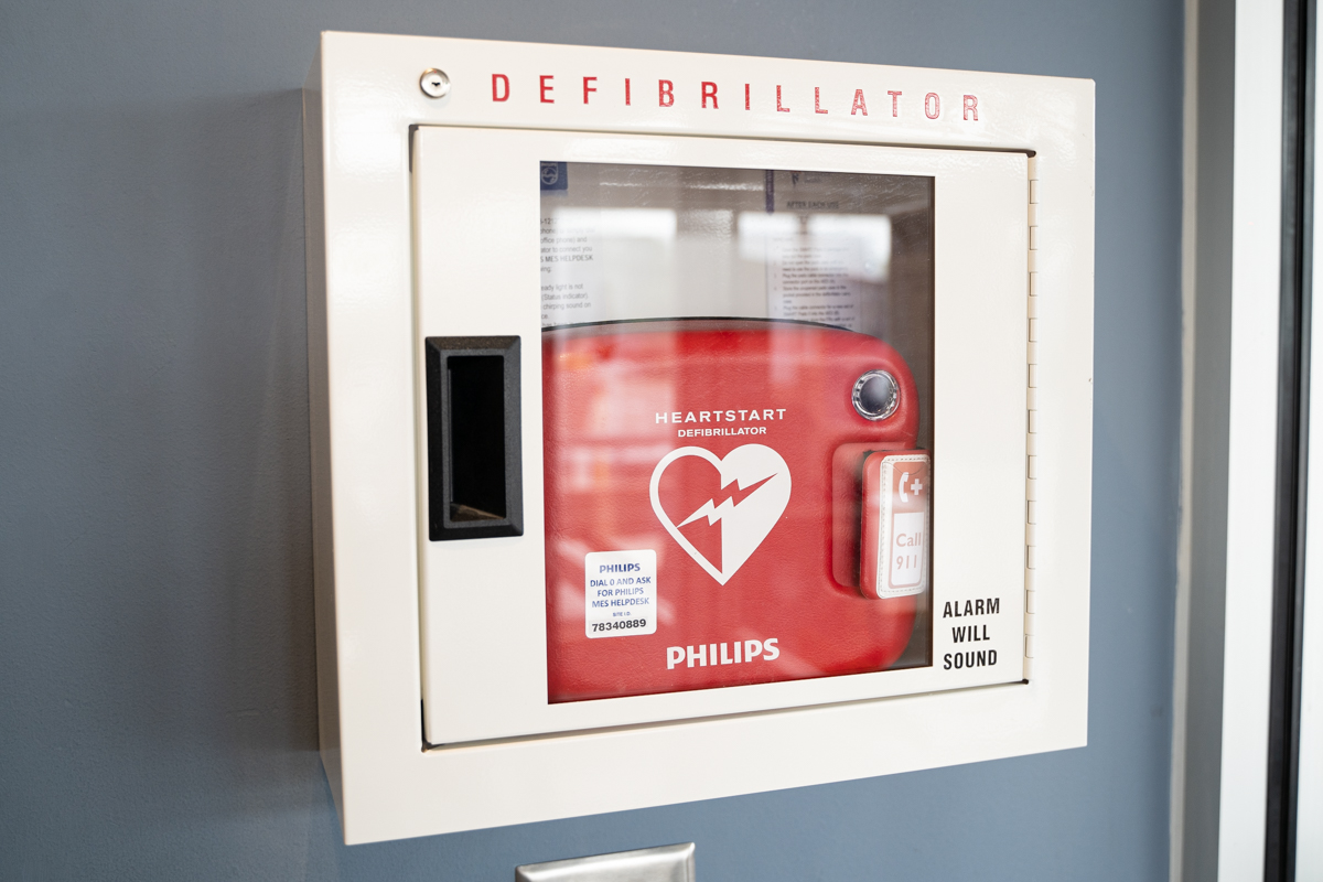 Picture of automated external defibrillator behind the door