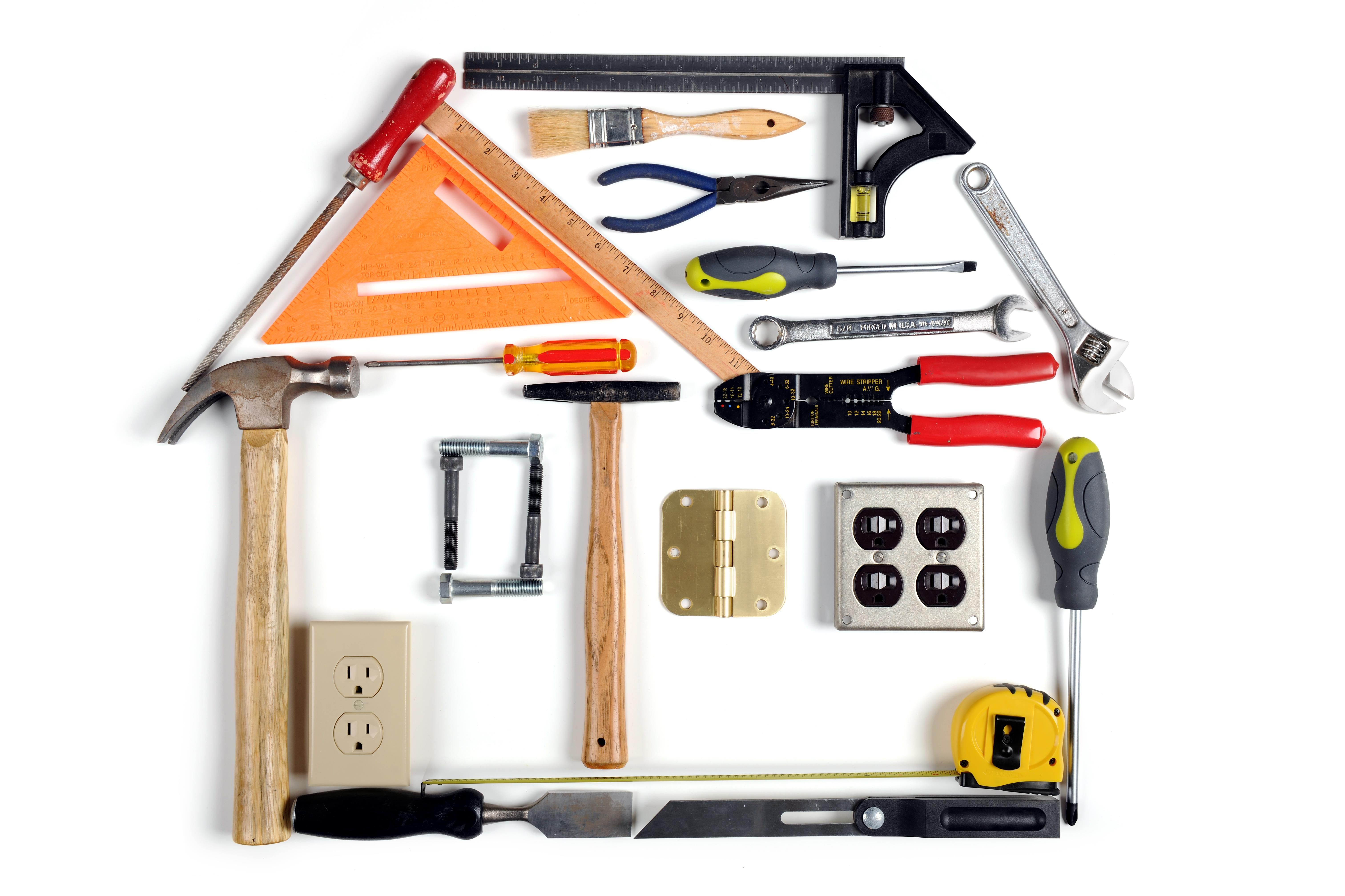 Construction tools forming the shape of a house