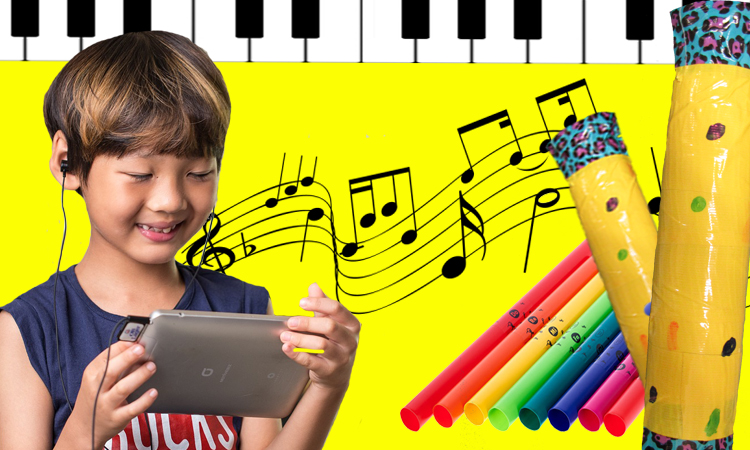 boy with ipad and musical instruments